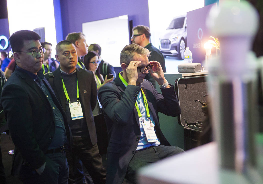 Martin Jurgensen of Denmark tries out smart glasses from Amazon-funded startup North in a room showcasing products integrated with Amazon's Alexa at the Sands Expo and Convention Center during CES ...