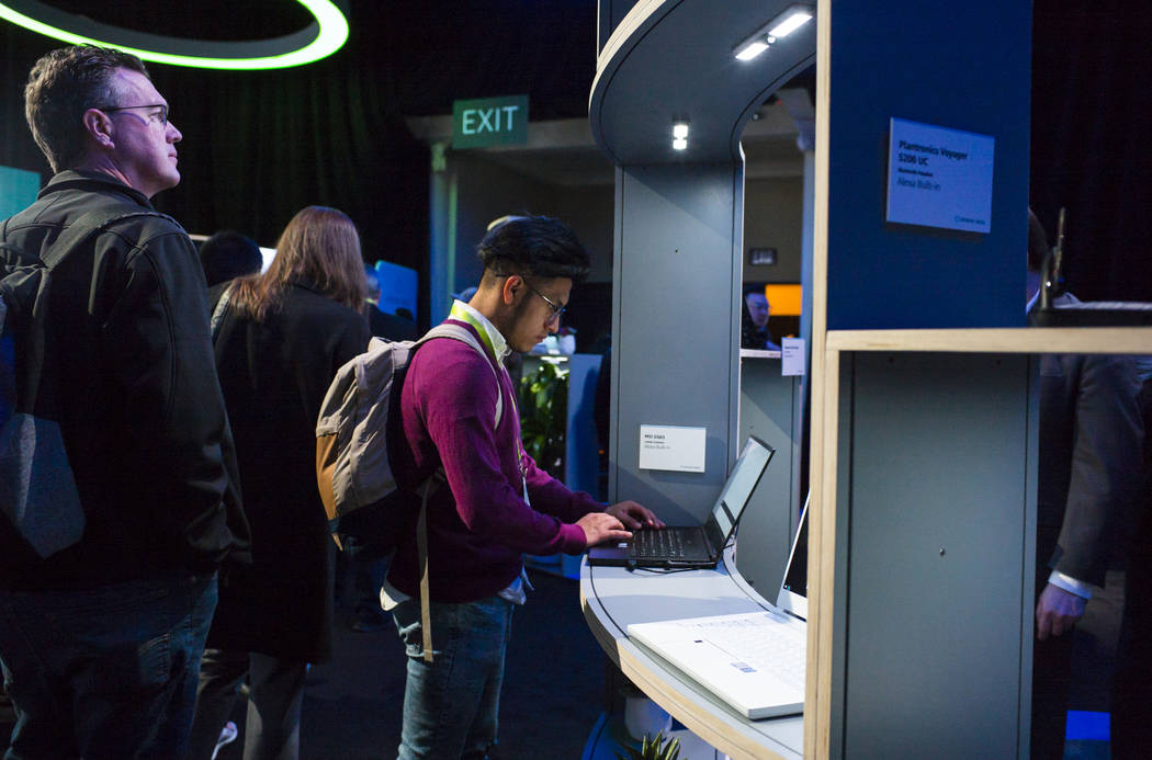 Erick Naunay of Oklahoma checks out the MSI GS65 gaming laptop with Alexa built-in at a room showcasing products integrated with Amazon's Alexa at the Sands Expo and Convention Center during CES i ...