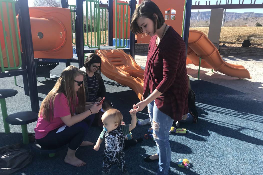 Ashley Lasater and her son, Milo, walk around the park on Thursday, Jan. 10. (Rachel Spacek/Las Vegas Review-Journal @RachelSpacek)