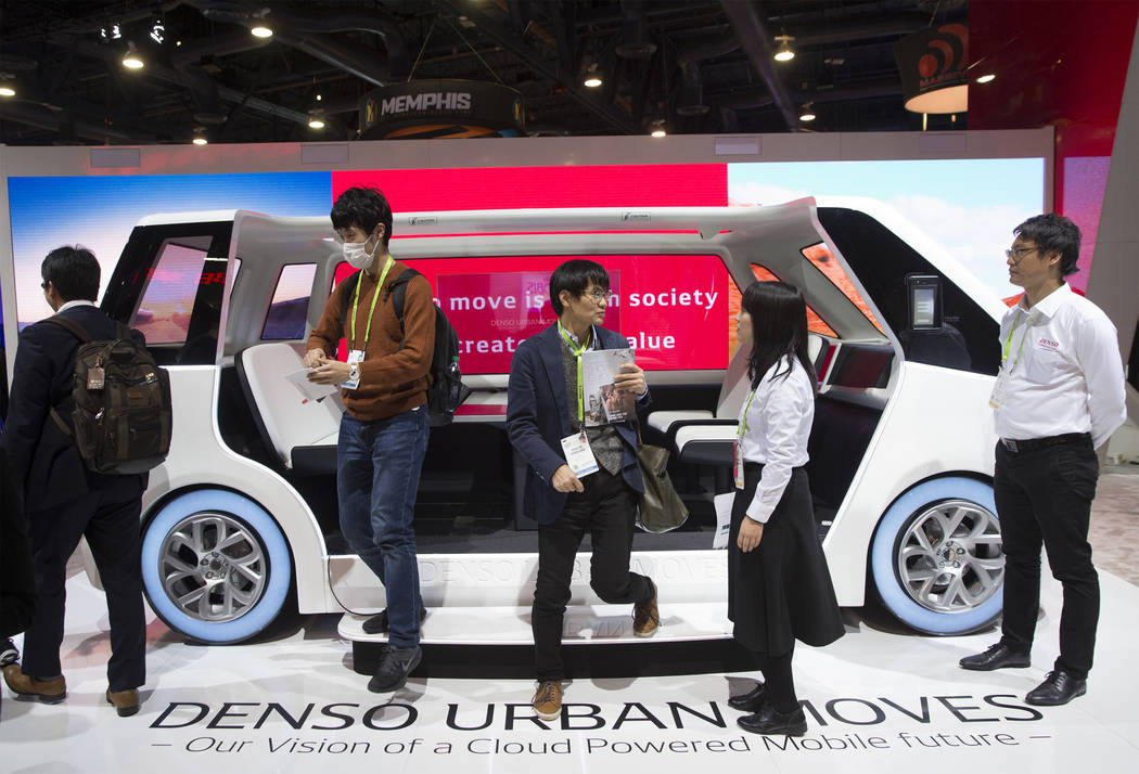 Convention goers explore the Denso Urban Moves autonomous vehicle in the North Hall during the second day of CES 2019 on Wednesday, Jan. 9, 2019, at the Las Vegas Convention Center, in Las Vegas. ...
