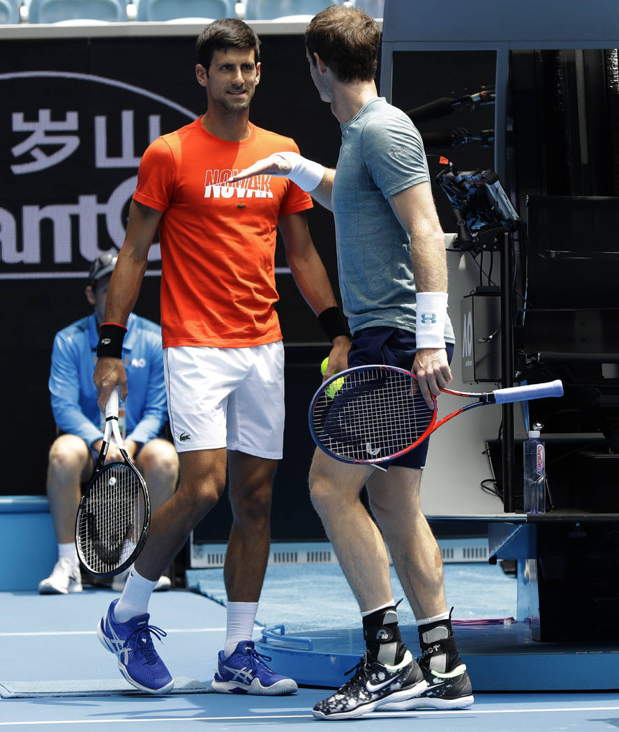 Britain's Andy Murray, right, gestures to Serbia's Novak Djokovic during a practice match on Margaret Court Arena ahead of the Australian Open tennis championships IN Melbourne, Australia, Thursda ...