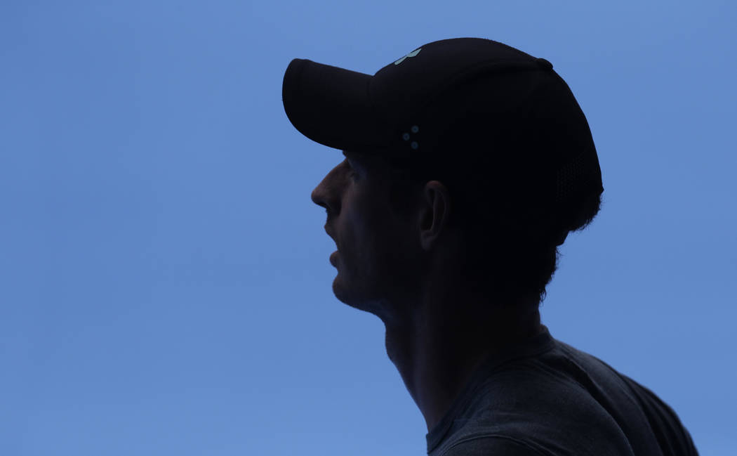 Britain's Andy Murray waits in the shade during his practice match against Serbia's Novak Djokovic on Margaret Court Arena ahead of the Australian Open tennis championships IN Melbourne, Australia ...