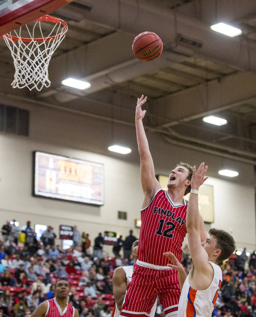 Findlay Prep's Jack Schwietz (12) lays up while Bishop Gorman's Chance Michels (25) tries to block him during the Big City Showdown at South Point in Las Vegas on Saturday, Jan. 20, 2018. Findlay ...