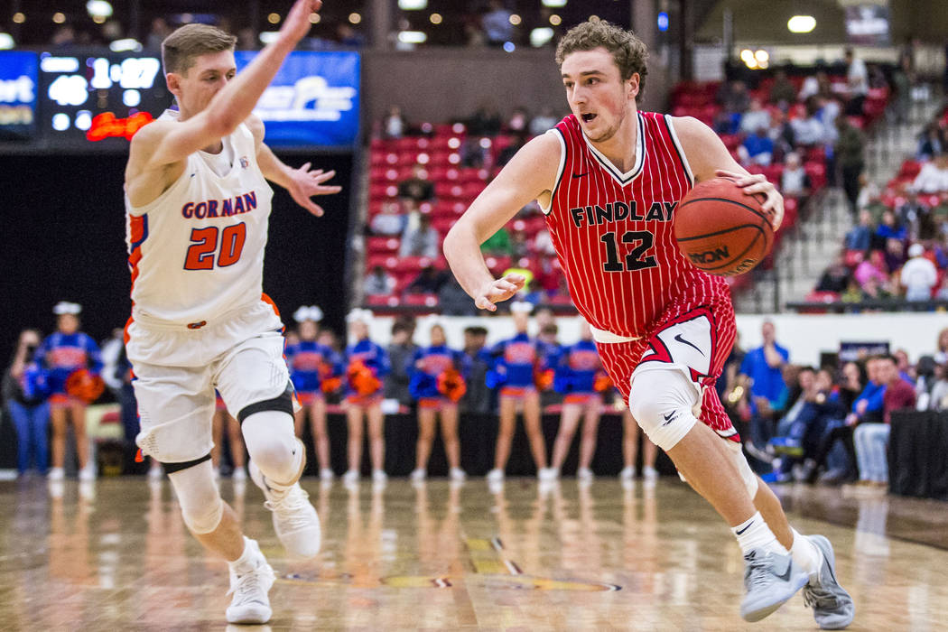 Findlay Prep's Jack Schwietz (12) drives toward the hoop while Bishop Gorman's Noah Taitz (20) looks to block him during the Big City Showdown at South Point in Las Vegas on Saturday, Jan. 20, 201 ...