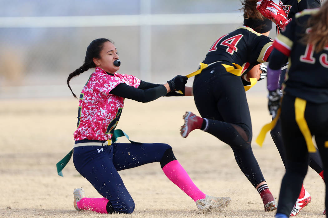 Green Valley junior Jazlyn Camacho (15) makes a tackle against SECTA's Emily Sepulveda (14) in the flag football game at Southeast Career Technical Academy in Las Vegas, Wednesday, Jan. 16, 2019. ...