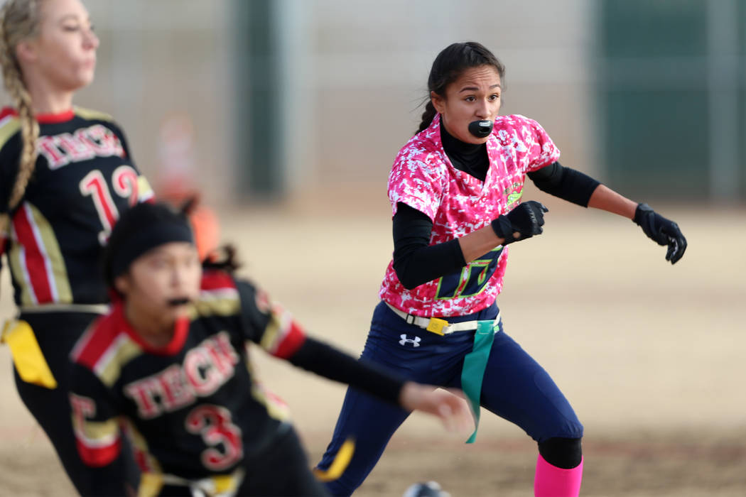 Green Valley junior Jazlyn Camacho (15) looks to make a defensive play against SECTA in the flag football game at Southeast Career Technical Academy in Las Vegas, Wednesday, Jan. 16, 2019. Erik Ve ...