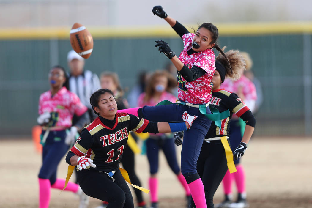 Green Valley junior Jazlyn Camacho (15) is short of making a catch against SECTA in the flag football game at Southeast Career Technical Academy in Las Vegas, Wednesday, Jan. 16, 2019. Erik Verduz ...