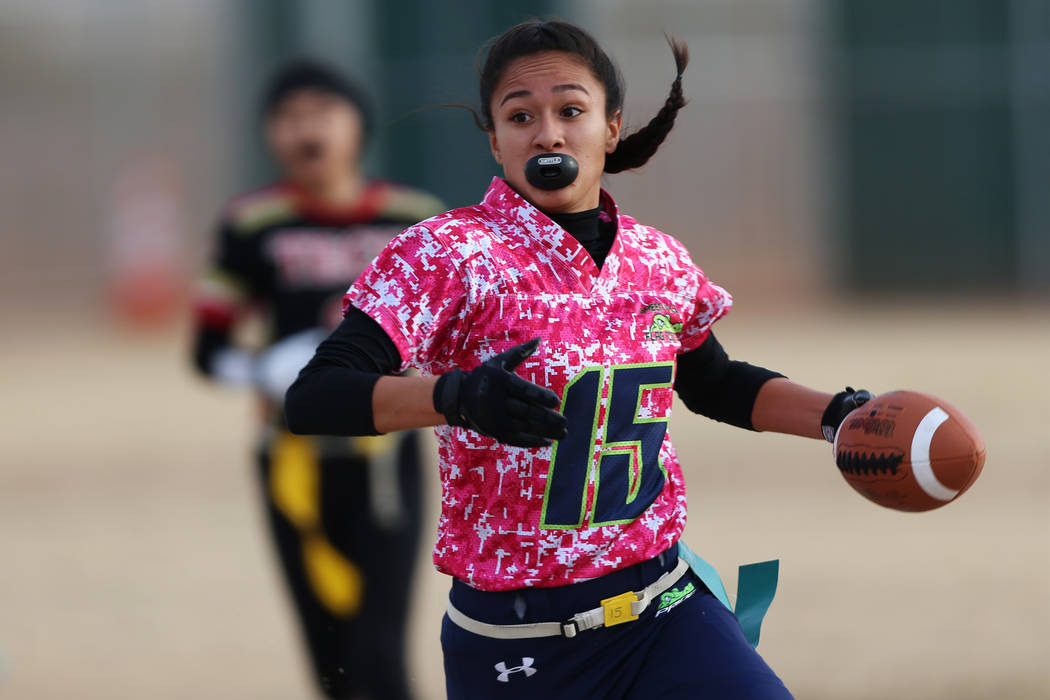 Green Valley junior Jazlyn Camacho (15) runs back an interception against SECTA in the flag football game at Southeast Career Technical Academy in Las Vegas, Wednesday, Jan. 16, 2019. Erik Verduzc ...
