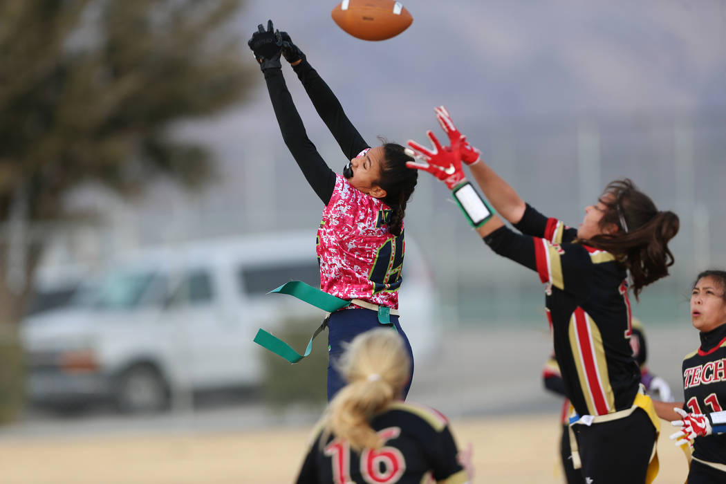Green Valley junior Jazlyn Camacho (15) is short of making a catch against SECTA at Southeast Career Technical Academy in the flag football game at Southeast Career Technical Academy in Las Vegas, ...