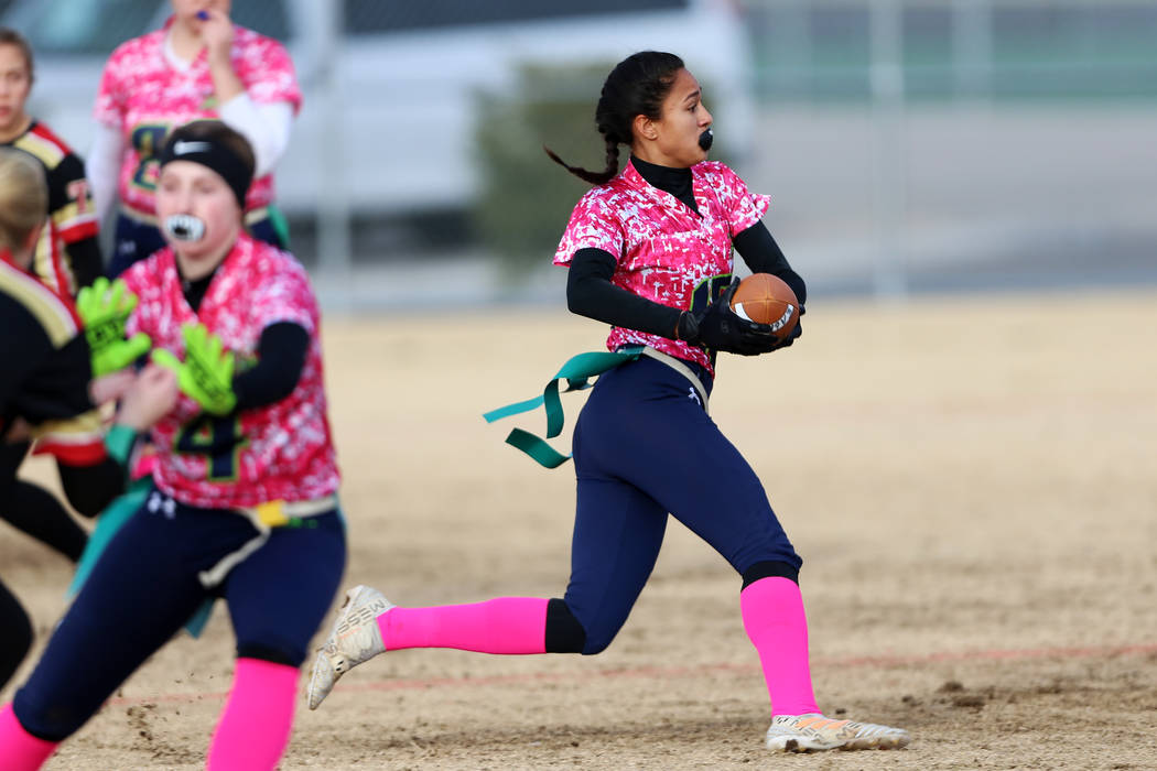Green Valley junior Jazlyn Camacho (15) runs the ball against SECTA at Southeast Career Technical Academy in the flag football game at Southeast Career Technical Academy in Las Vegas, Wednesday, J ...