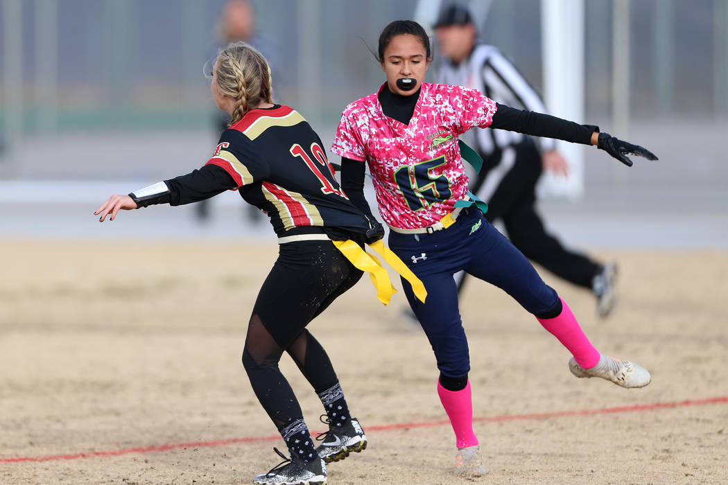 Green Valley junior Jazlyn Camacho (15) runs to make a tackle against SECTA'S Taylor Ritayik (12) in the flag football game at Southeast Career Technical Academy in Las Vegas, Wednesday, Jan. 16, ...