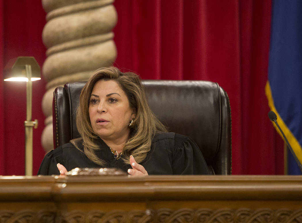 Nevada Supreme Court Justice Abbi Silver asks a questions during the first arguments for the new 2019 court in Las Vegas, Tuesday, Jan. 8, 2019. The two new justices elected are women, including S ...