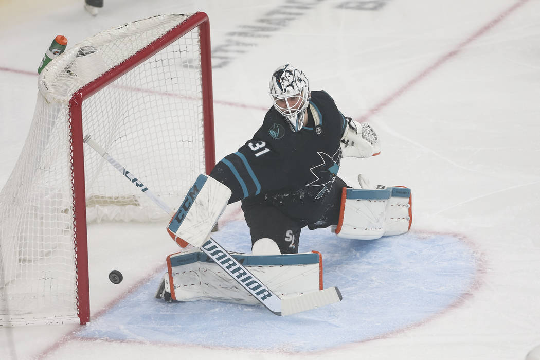 Vegas Golden Knights left wing Tomas Nosek (not shown) scores on San Jose Sharks goaltender Martin Jones (31) during the first period of an NHL hockey game at T-Mobile Arena in Las Vegas on Thursd ...
