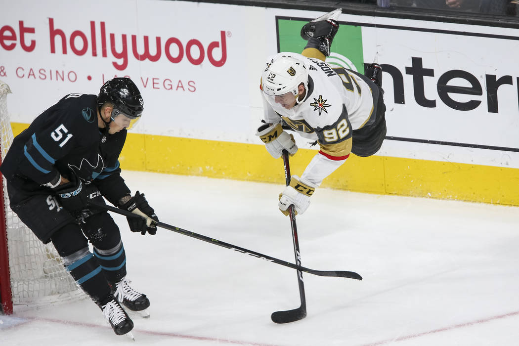 Vegas Golden Knights left wing Tomas Nosek (92) falls to the ice as he takes a shot past San Jose Sharks defenseman Radim Simek (51) during the second period of an NHL hockey game at T-Mobile Aren ...