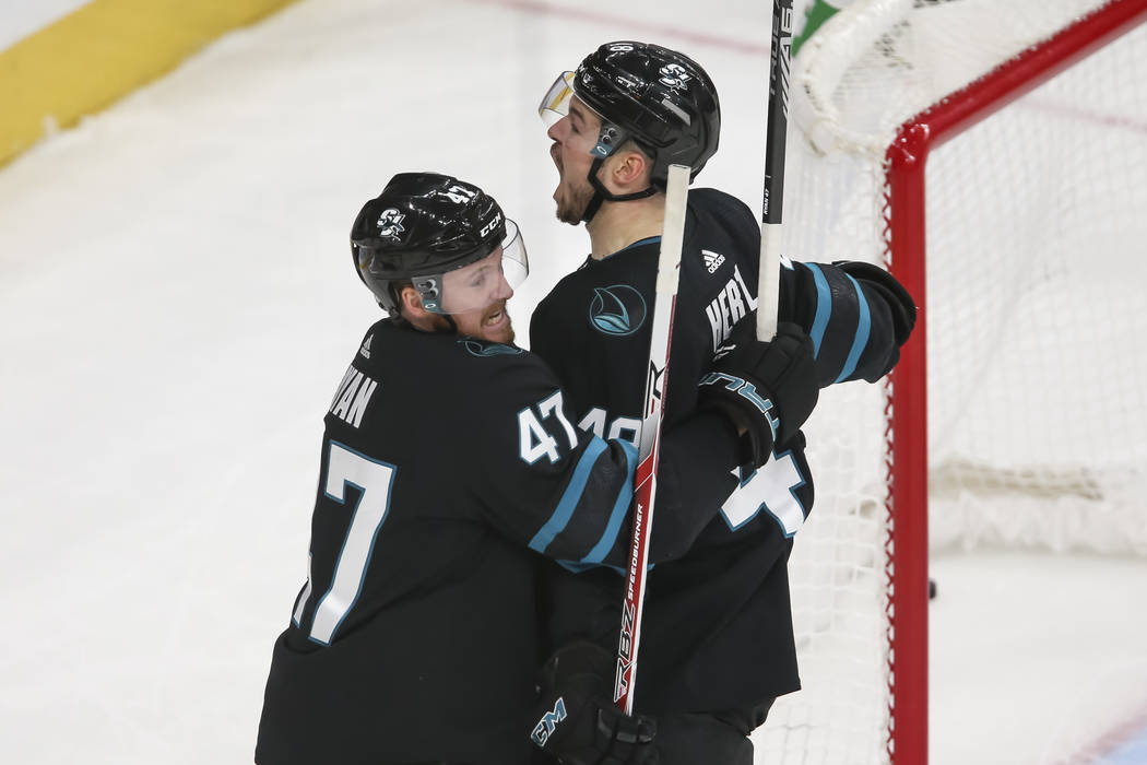 San Jose Sharks center Tomas Hertl (48), right, and defenseman Joakim Ryan (47) celebrate Hertl's second period goal during an NHL hockey game against the Vegas Golden Knights at T-Mobile Arena in ...
