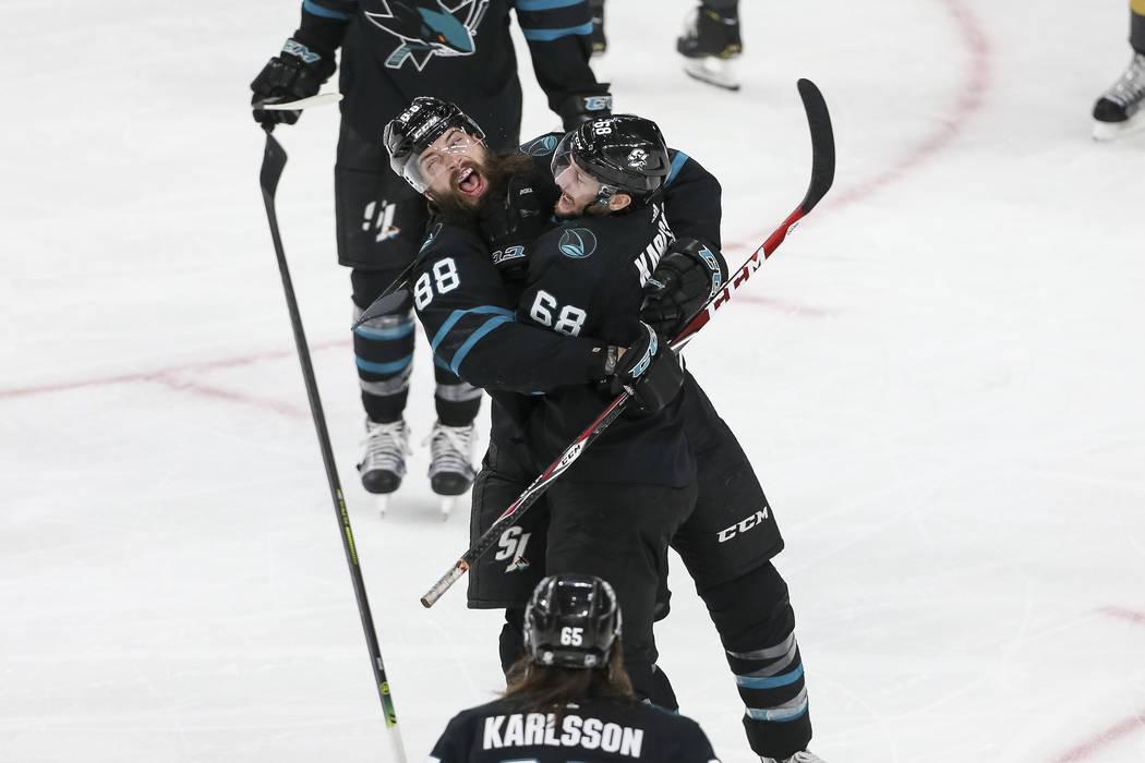 San Jose Sharks defenseman Brent Burns (88) embraces Sharks center Melker Karlsson (68) celebrating Karlsson's third period goal during an NHL hockey game against the Vegas Golden Knights at T-Mob ...