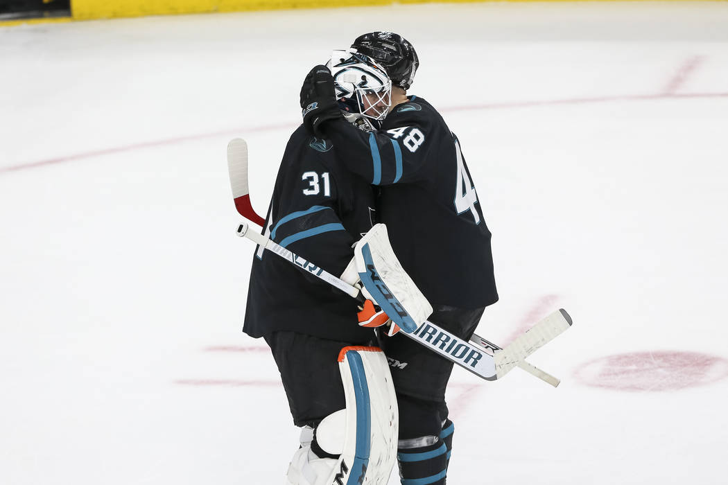 San Jose Sharks center Tomas Hertl (48) and Sharks goaltender Martin Jones (31) celebrate their 3-2 victory over the Vegas Golden Knights following an NHL hockey game at T-Mobile Arena in Las Vega ...