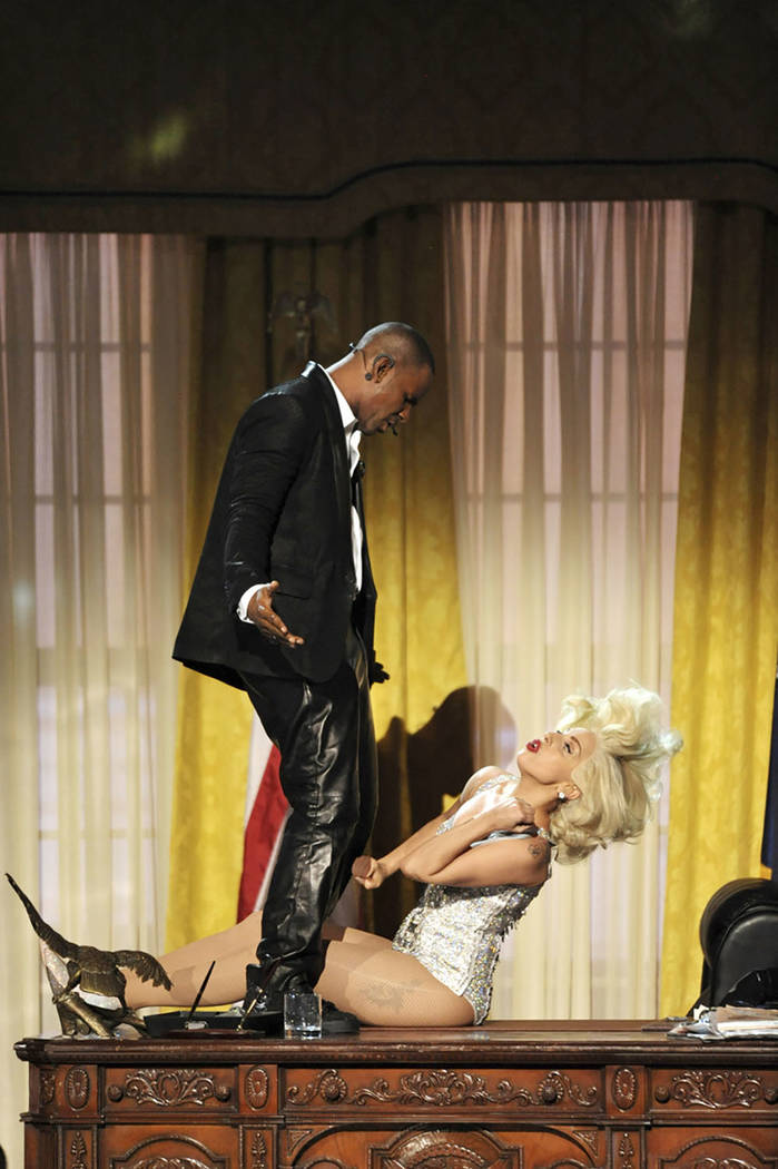 "In this Nov. 24, 2013 file photo, Lady Gaga, right, and R. Kelly perform ""Do What U Want (With My Body)"" at the American Music Awards in Los Angeles. (Photo by John Shearer/Invision/AP)"