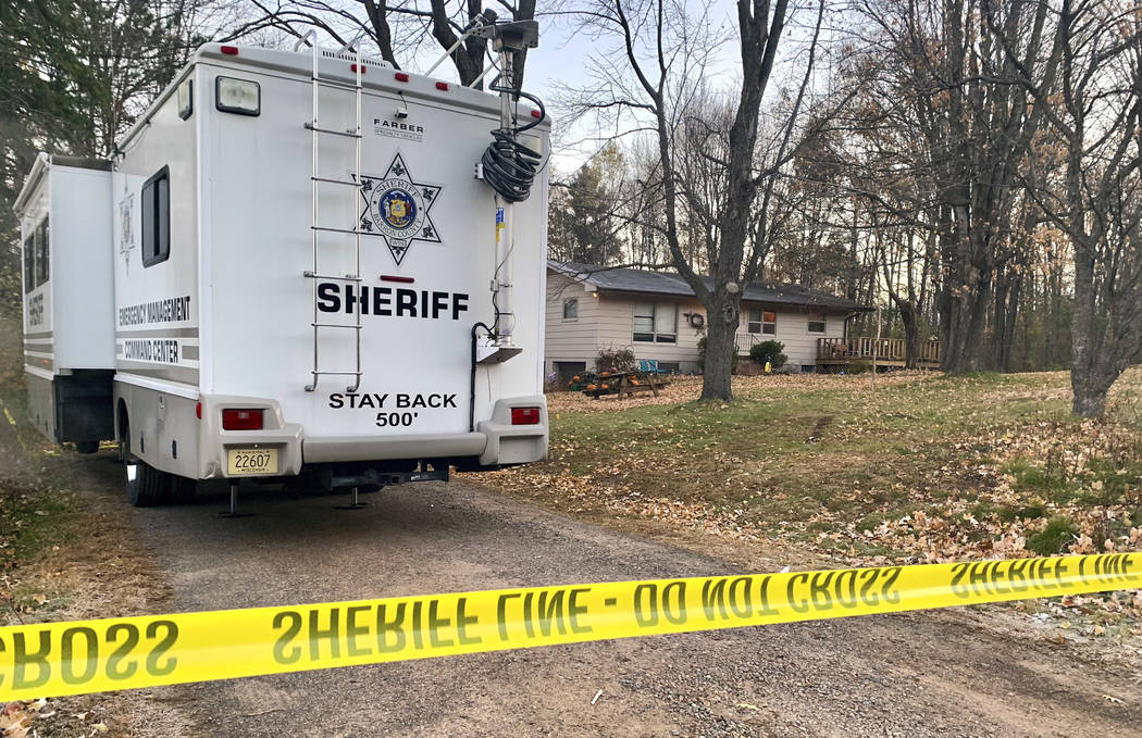 FILE - In this Oct. 23, 2018, file photo, a Barron County, Wis., sheriff's vehicle is parked outside the home where James Closs and Denise Closs were found fatally shot on Oct. 15. The Barron Coun ...
