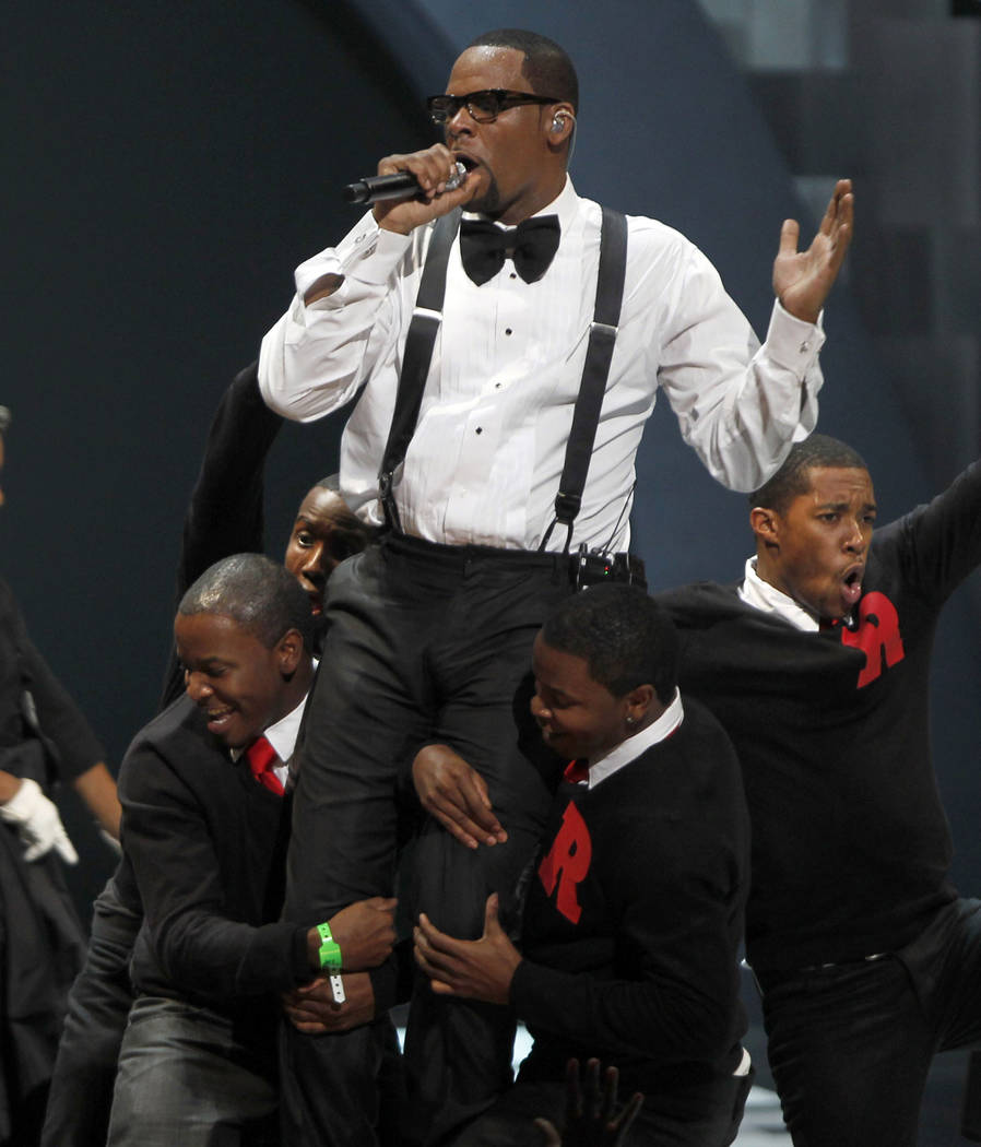 """Singer R. Kelly performs """"When A Woman Loves,"""" during the Soul Train awards in Atlanta on Nov. 10, 2010. (AP Photo/David Goldman, file)"""