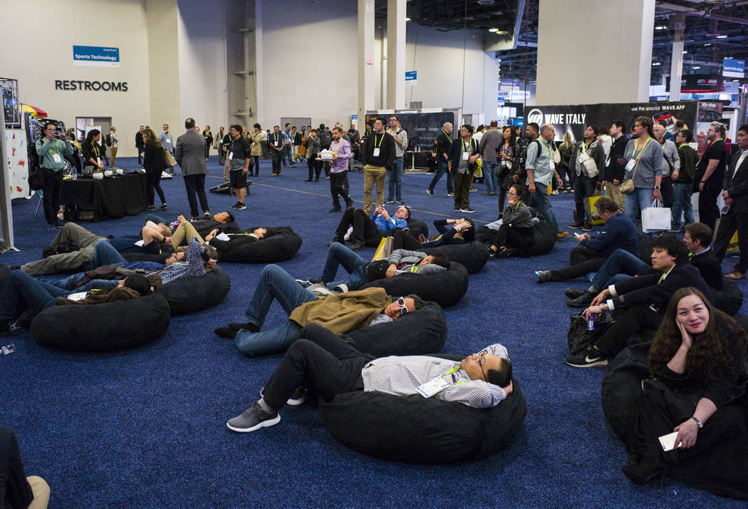 Attendees relax at the Sands Expo and Convention Center during CES in Las Vegas on Wednesday, Jan. 9, 2019. Chase Stevens Las Vegas Review-Journal @csstevensphoto