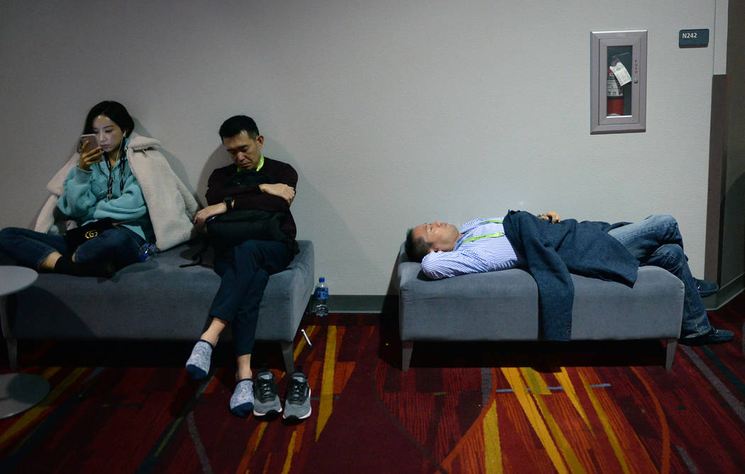 Attendees take a break to rest at the Las Vegas Convention Center during the third day of CES in Las Vegas, Thursday, Jan. 10, 2019. Caroline Brehman/Las Vegas Review-Journal