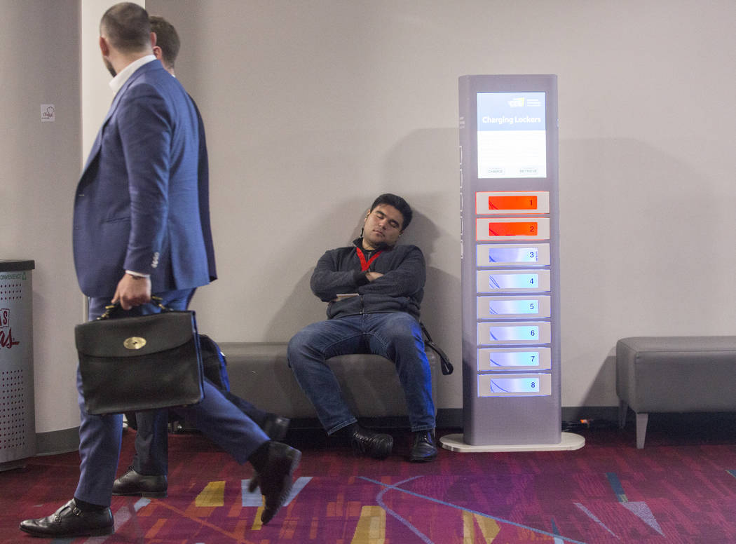 Convention goers get sleep where they can during the last day of CES 2019 on Friday, Jan. 11, 2019, at the Las Vegas Convention Center, in Las Vegas. The four day tech event brings over 4,500 vend ...