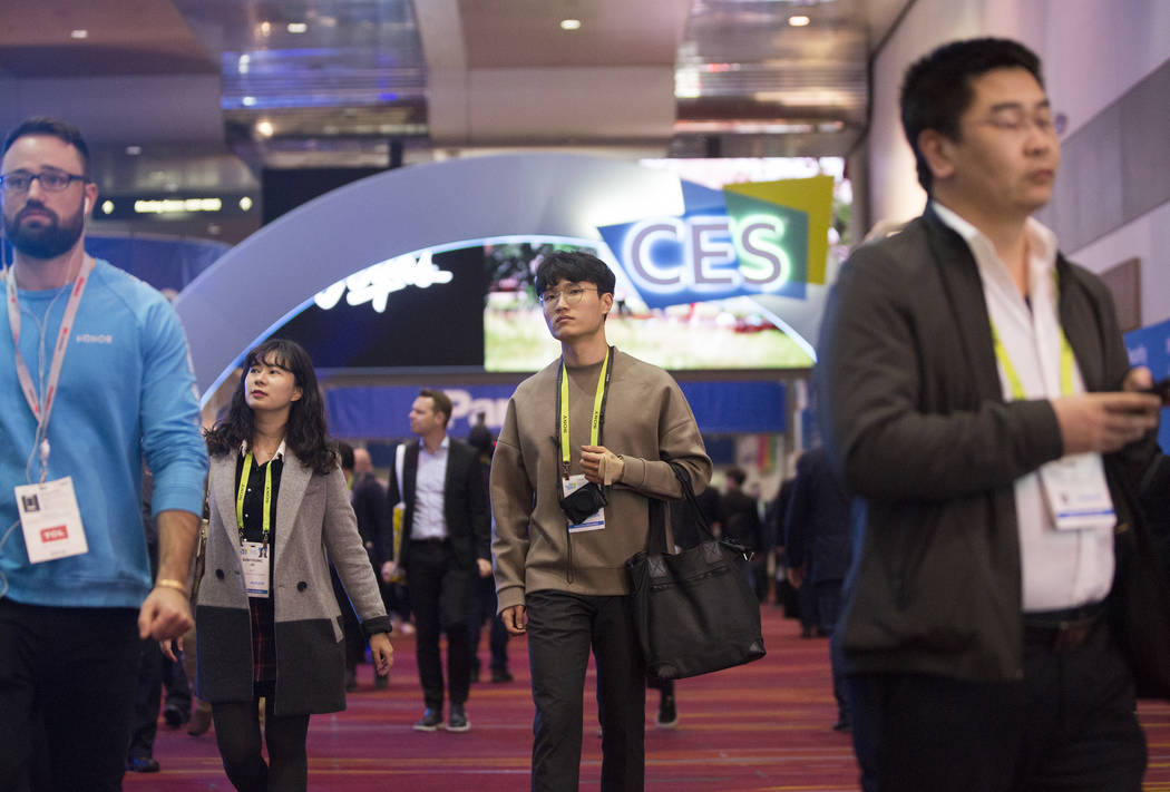 Convention goers explore the Central Hall during the last day of CES 2019 on Friday, Jan. 11, 2019, at the Las Vegas Convention Center, in Las Vegas. The four day tech event brings over 4,500 vend ...