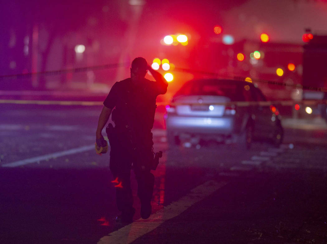 A Davis police officer was shot and killed Thursday night while responding to a traffic accident, and authorities cordoned off parts of downtown while searching for a suspect. (Jose Luis Villegas ...