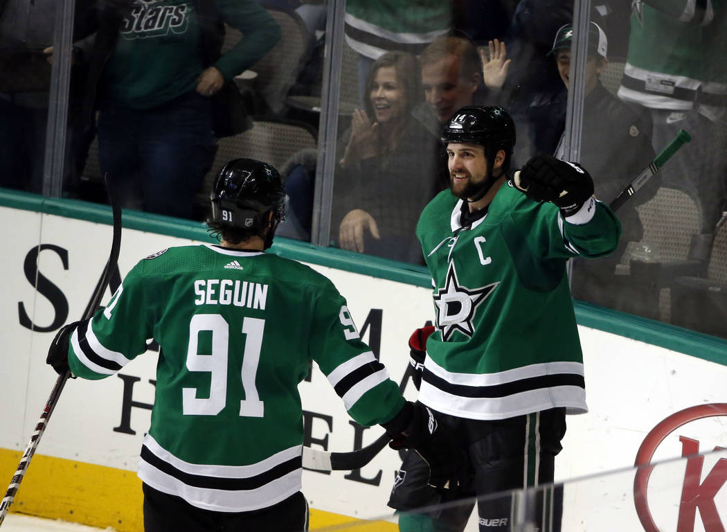 Dallas Stars left wing Jamie Benn, right, celebrates his goal with Stars center Tyler Seguin (91) against the Montreal Canadiens during the second period of an NHL hockey game in Dallas, Monday, D ...