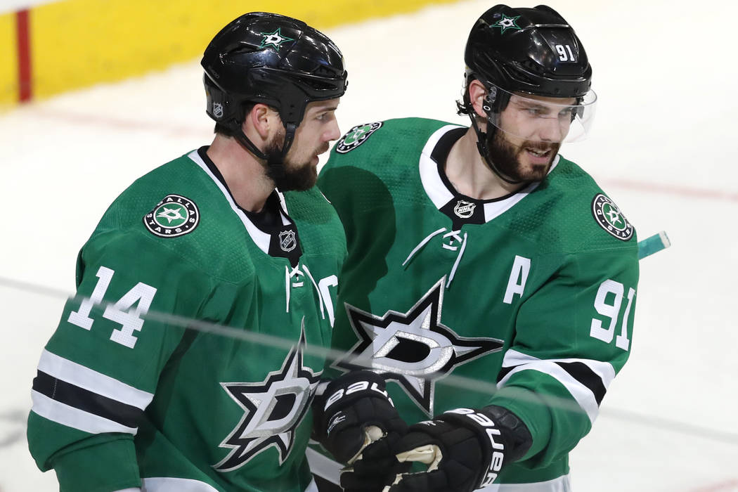 ba3278691 Dallas Stars left wing Jamie Benn (14) is congratulated by teammate center  Tyler Seguin