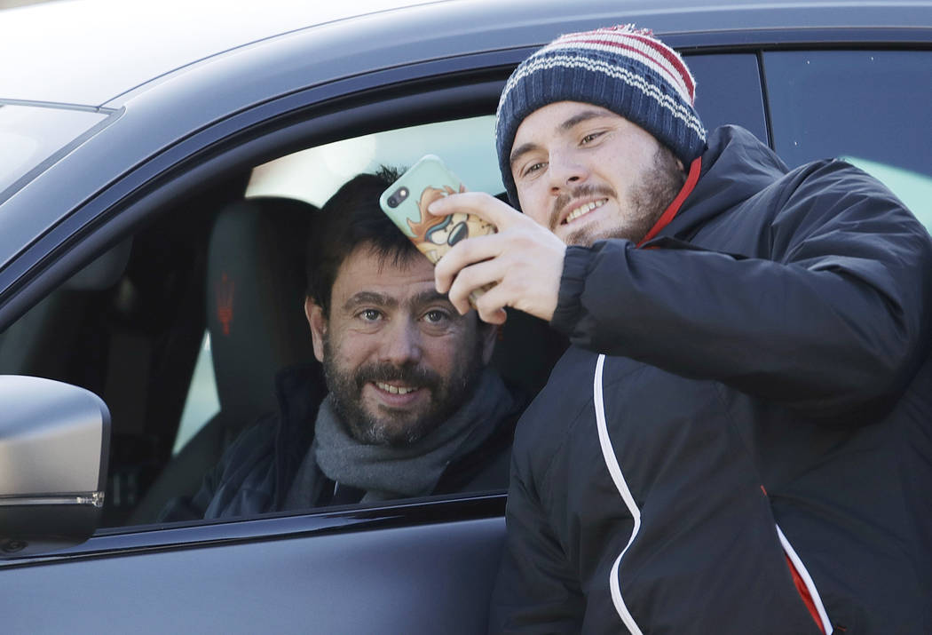 A supporter takes a picture with Juventus' president Andrea Agnelli as he arrives for a training session at the Continassa Juventus center, in Turin, Italy, Friday, Jan. 11, 2019. Las Vegas police ...