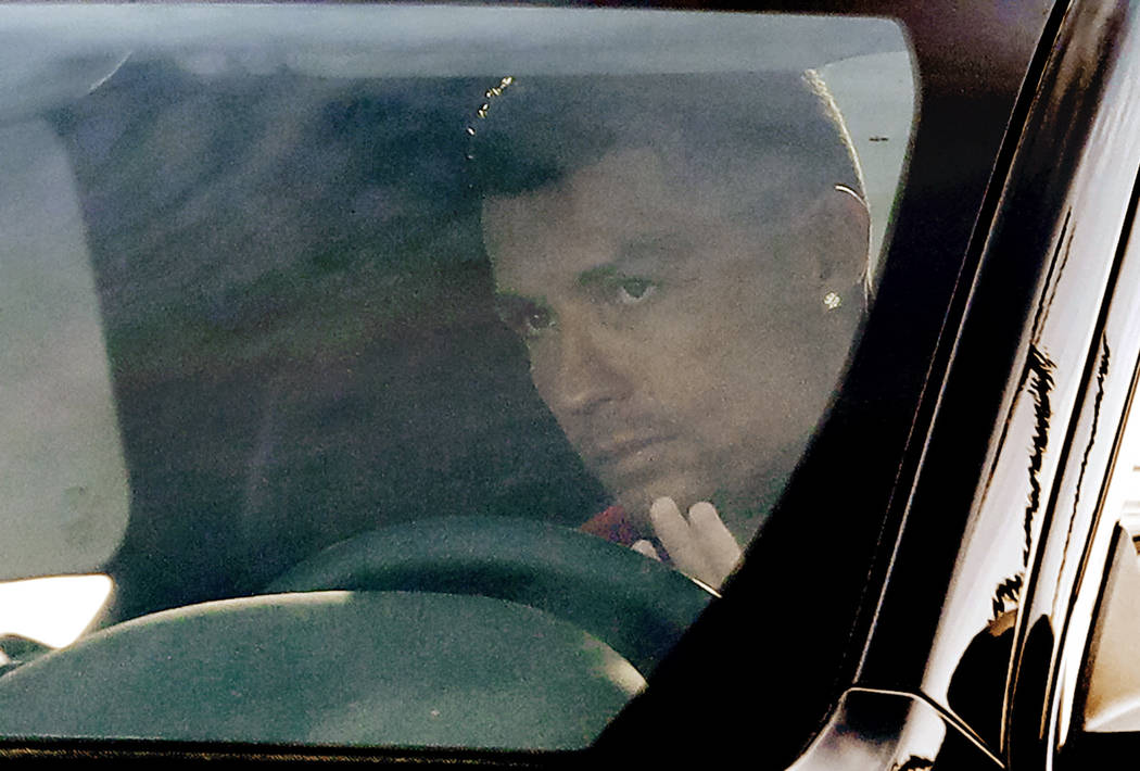 Juventus' Cristiano Ronaldo waves to supporters and drives his car as he arrives for a training session at the Continassa Juventus center, in Turin, Italy, Friday, Jan. 11, 2019. Las Vegas police ...