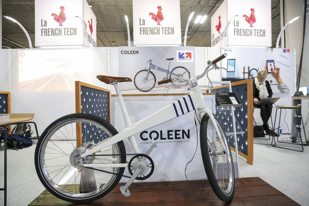 Coleen, an electric bike built in France and modeled after a classic Jean ProuvŽ design, on display at the Coleen France booth during the final day of CES at the Sands Expo Convention Center ...
