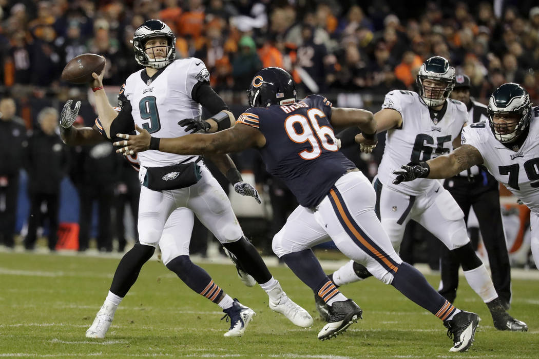 Philadelphia Eagles quarterback Nick Foles (9) throws as Chicago Bears defensive end Akiem Hicks (96) pressures him during the first half of an NFL wild-card playoff football game Sunday, Jan. 6, ...