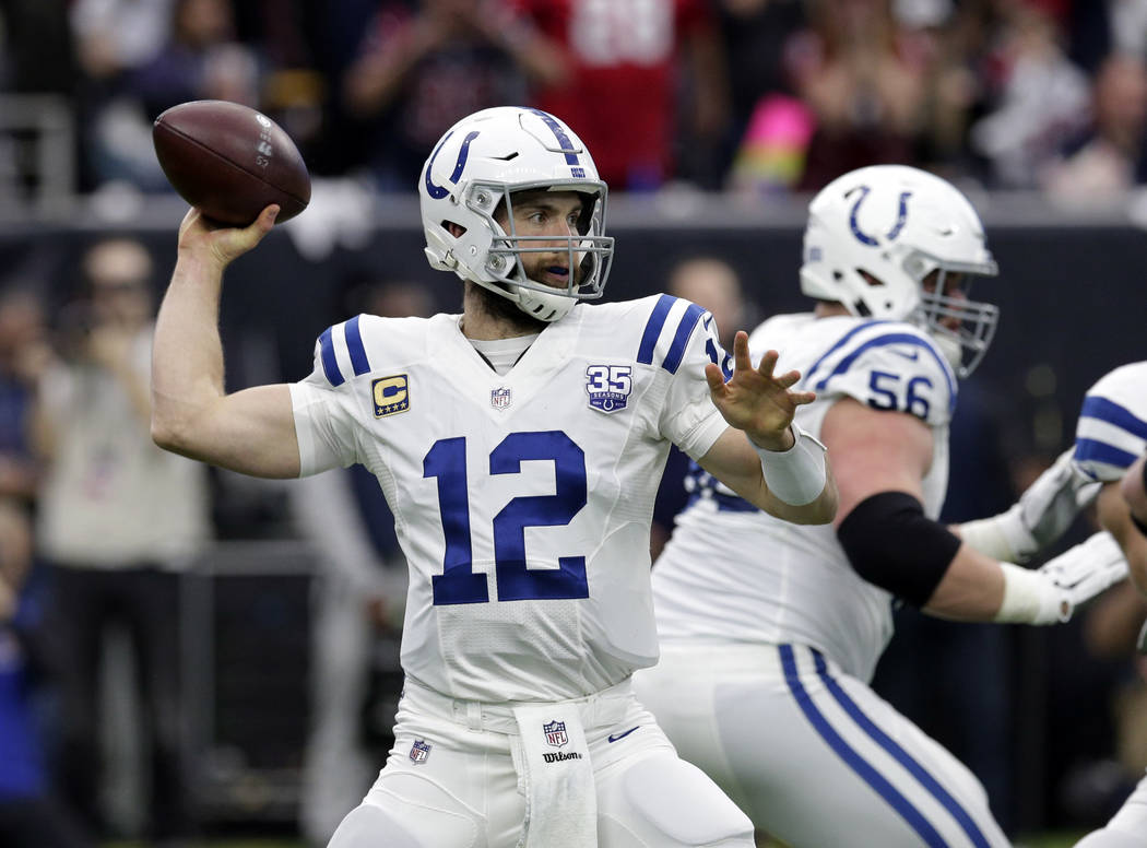 FILE - In this Jan. 5, 2019 file photo Indianapolis Colts quarterback Andrew Luck (12) throws against the Houston Texans during the first half of an NFL wild card playoff football game in Houston. ...