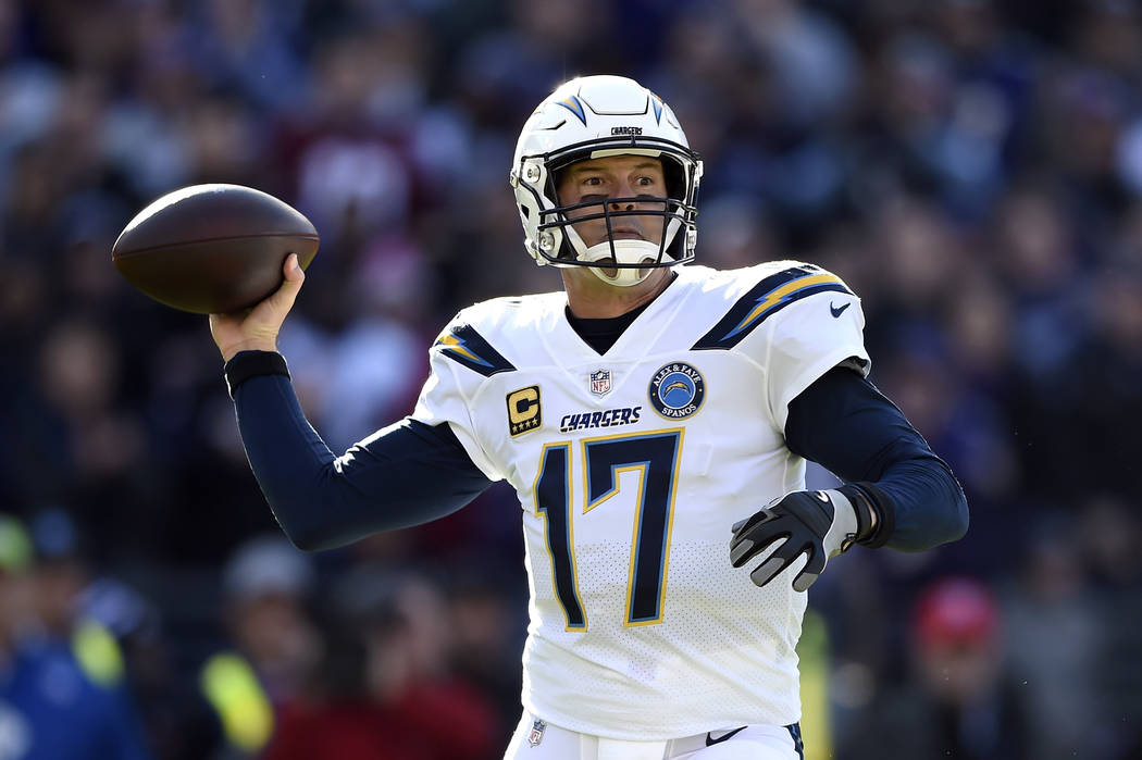 Los Angeles Chargers quarterback Philip Rivers throws a pass in the first half of an NFL wild card playoff football game against the Baltimore Ravens, Sunday, Jan. 6, 2019, in Baltimore. (AP Photo ...