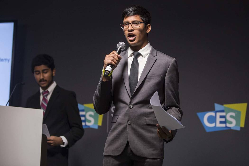 Ishaan Raja, right, and Anish Chejerla present their device designed to protect small businesses from cyber attacks during the Future Innovators Student Business Pitch Competition on the last day ...