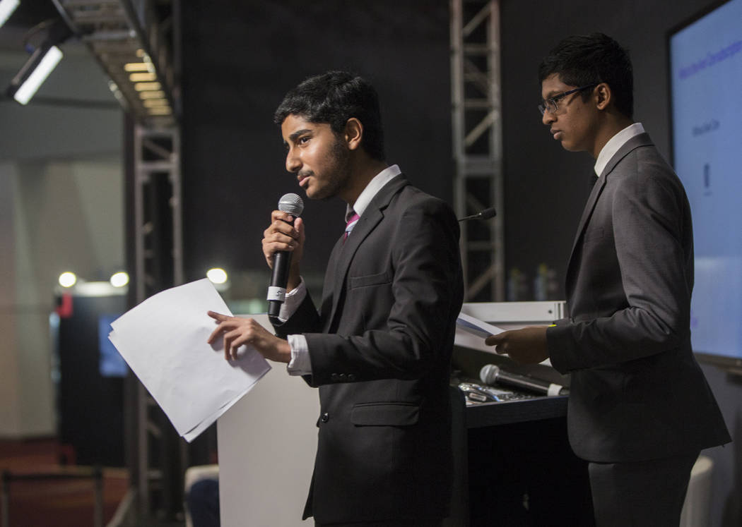 Anish Chejerla, left, and Ishaan Raja present their device designed to protect small businesses from cyber attacks during the Future Innovators Student Business Pitch Competition on the last day o ...