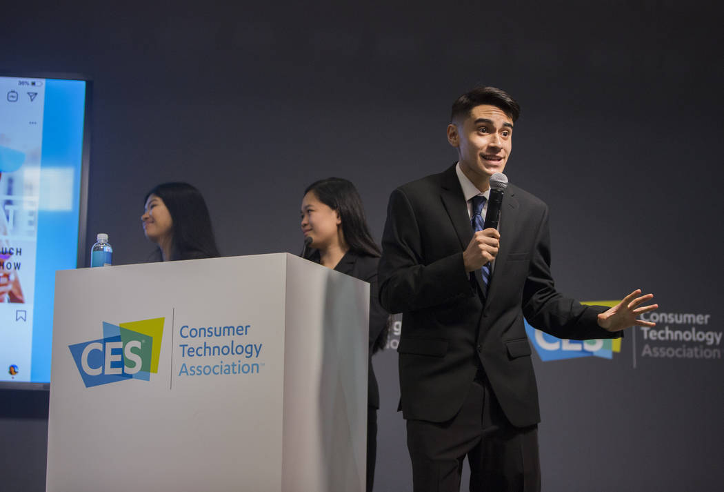 Jose Lugo, right, Cherese Lisama and Jaslin Estavillo pitch their financial app Moneybyte during the Future Innovators Student Business Pitch Competition on the last day of CES 2019 on Friday, Jan ...