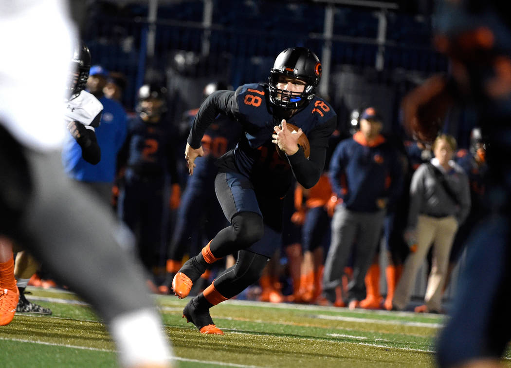 Bishop Gorman quarterback Tate Martell runs with the ball against Palo Verde during the first half of a high school football game at Bishop Gorman High School, Thursday, Nov. 10, 2016, in Las Vega ...