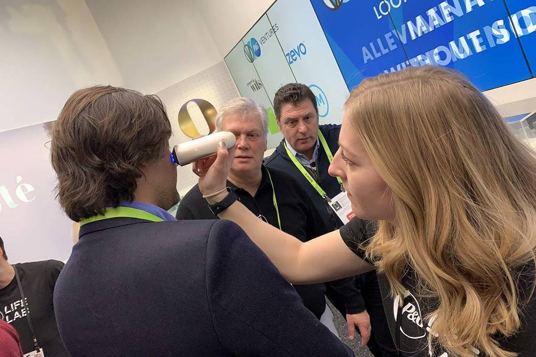 Opte from Proctor and Gamble, a device for correcting spots and freckles from skin, is demonstrated at CES 2019 in Las Vegas, Friday, Jan. 11, 2019. Opte analyzes the area for spots and then cover ...