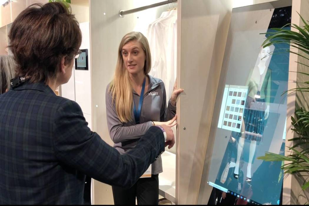 Aviona Carrigan, a Haier exhibitor, discusses the Haier smart mirror, available in China. (Bailey Schulz/Las Vegas Review-Journal)