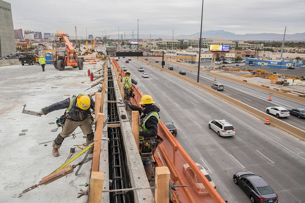 Construction continues on the HOV ramp in the Spaghetti Bowl as part of Project Neon on Wednesday, Dec. 5, 2018, in Las Vegas. (Benjamin Hager/Las Vegas Review-Journal)