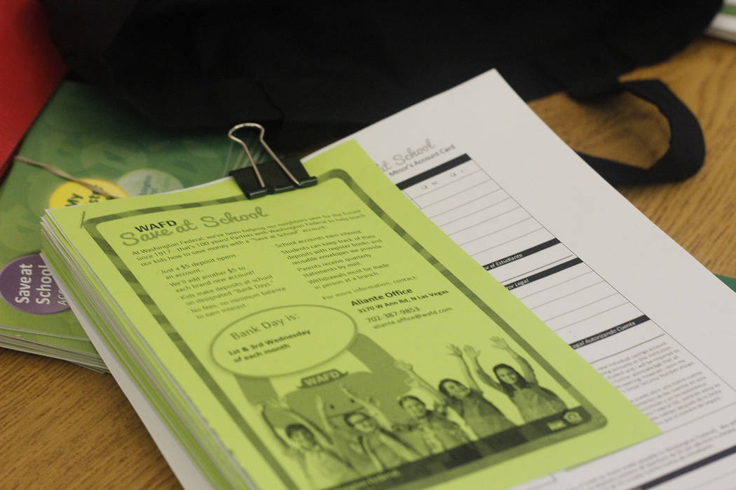 Materials explaining the Save at School program are seen at Scott Elementary. (Mia Sims/Las Vegas Review-Journal @miasims___)