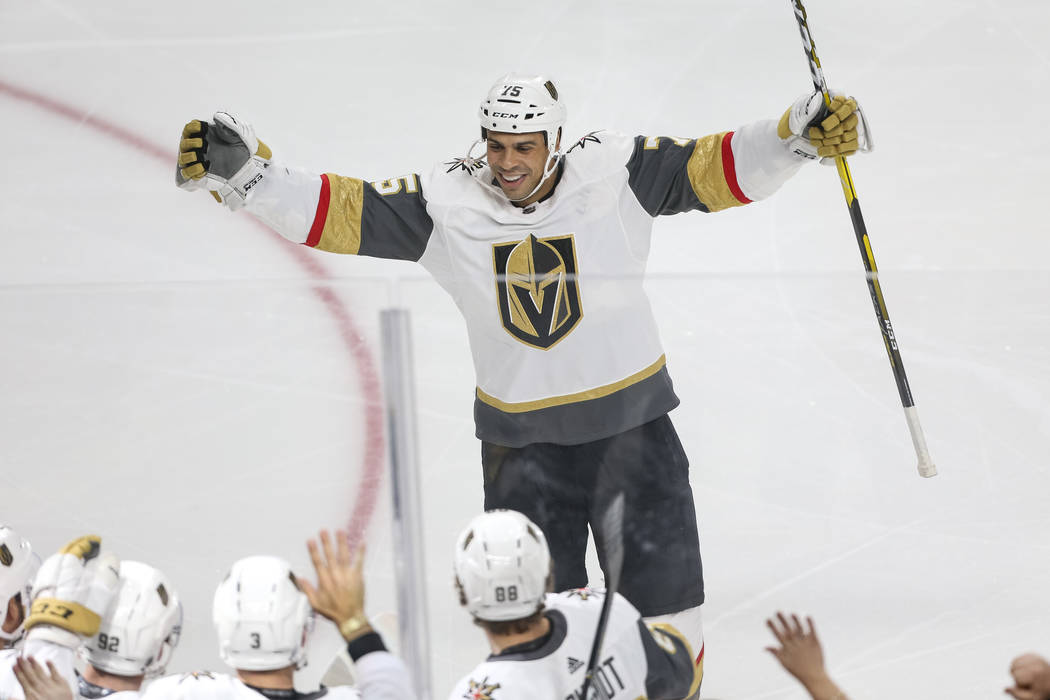 Vegas Golden Knights right wing Ryan Reaves (75) skates to his teammates to celebrate a first period goal by left wing Tomas Nosek (92) during an NHL hockey game against the San Jose Sharks at T-M ...