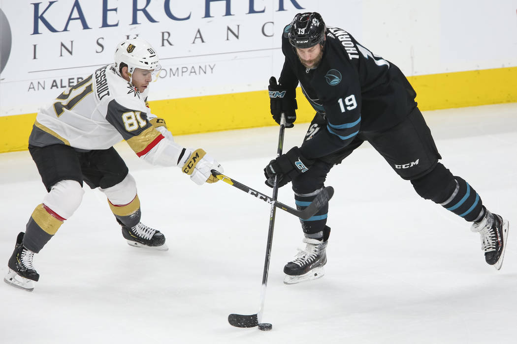 Vegas Golden Knights center Jonathan Marchessault (81) defends against San Jose Sharks center Joe Thornton (19) during the first period of an NHL hockey game at T-Mobile Arena in Las Vegas on Thur ...