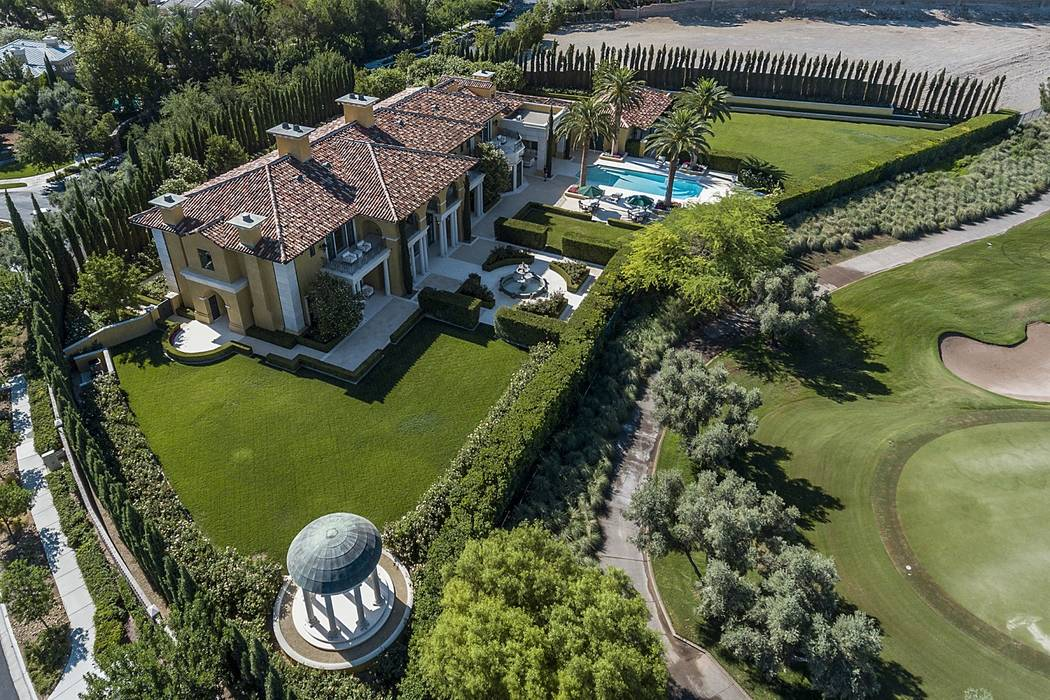 The mansion at 1717 Enclave Court in Las Vegas, seen above, sold for $13 million in March 2018. (Queensridge Realty)