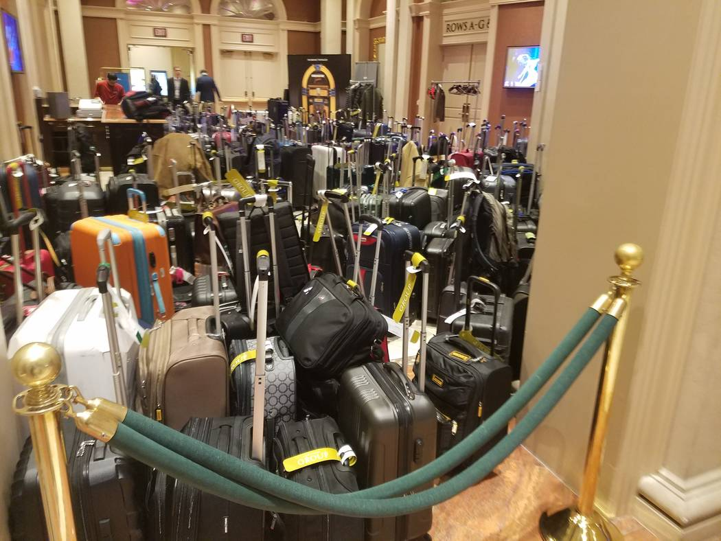 Suitcases are packed into an area at Sands Expo. (Heidi Knapp Rinella/Las Vegas Review-Journal)