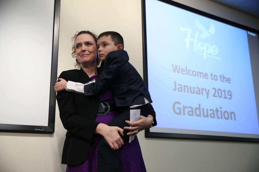 Ashley Olivetti with her son Ashton Carter, 7, during her graduation from Hope For Prisoners at the Las Vegas Metropolitan Police Department headquarters in Las Vegas, Friday, Jan. 11, 2019. Erik ...